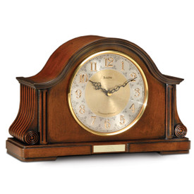 bulova chadborne chiming clock with two-tone metallic face and gold-tone bezel