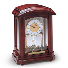 bulova nordale solid wood clock with walnut finish and brass-toned rotating pendulum