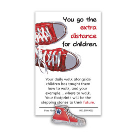 red sneaker lapel pin with extra distance message card