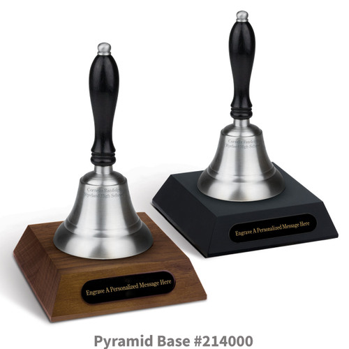 black and a brown walnut pyramid bases with black brass plates and pewter bells