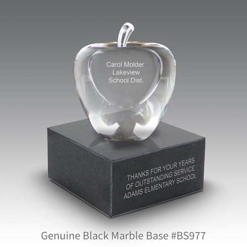 optic crystal apple with personalization sitting on top a black marble base with black brass plate