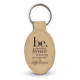 light brown oval leather keychain with be collection message
