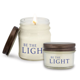 two white candle in glass jar with be the light message