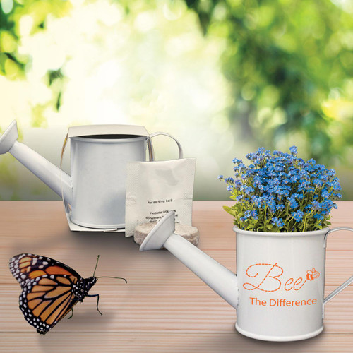 forget-me-nots in mini watering can with a butterfly