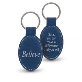 blue oval leather keychains with believe message and personalizaton