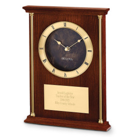Bulova Achievement Clock featuring brass-tone accent columns and chapter ring with raised Roman numerals.
