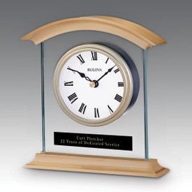 Bulova Bristol Clock featuring brushed brass metal, thick glass, and bold Roman numerals.
