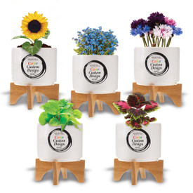 Modern white ceramic planter with bamboo stand featuring your full color logo or design. 3 seed packets to choose from.