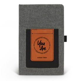 Canvas journal with phone pocket and card holder featuring the inspirational message Engaging Hearts Equipping Minds. 3 colors to choose from.