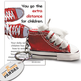 red sneaker key ring with you go the extra distance message card