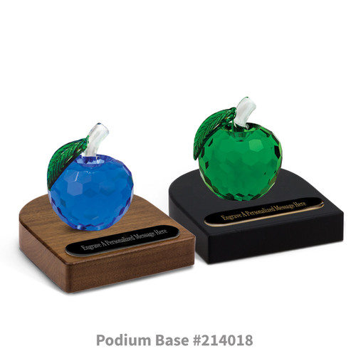 blue and green faceted crystal apples sitting on top of black and brown walnut podium bases with black brass plates