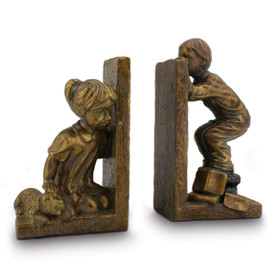 gold-toned resin bookends with boy, girl, and dog playing hide-n-seek