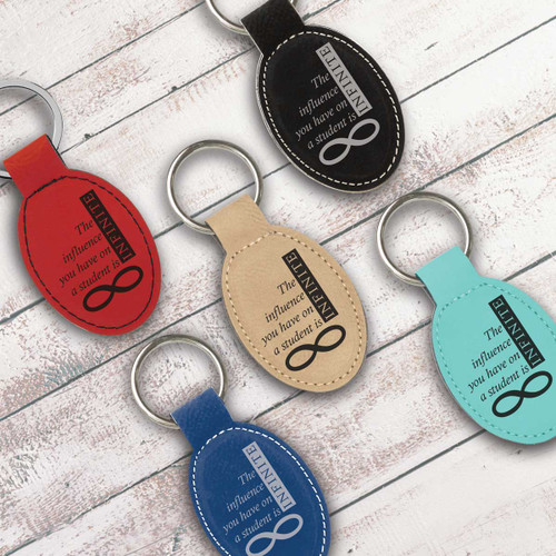multiple colors of oval keychains with infinity message