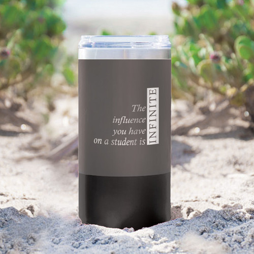 two tone charcoal stainless steel tumbler with infinity message sitting in sand
