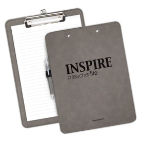 """9""""w x 12.5""""h Richly Textured Clipboard Featuring The Inspirational Message: Inspire #teacherlife. Available In 5 Colors."""