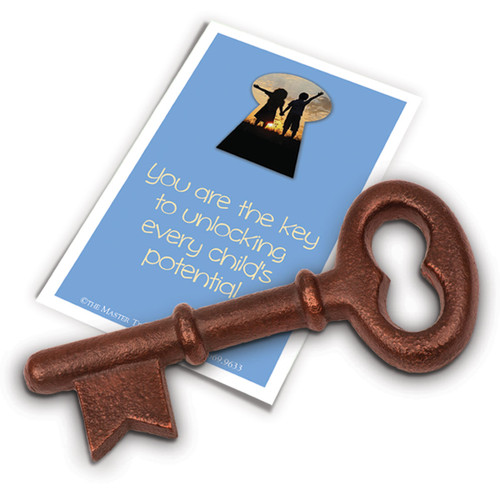 key-shaped paperweight with you are the key message card