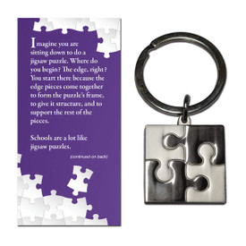 This polished silver, puzzle piece keychain is an affordable functional gift for teachers.
