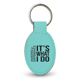 teal oval leather keychain with making a difference message