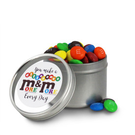 round tin with make a difference message and M&Ms