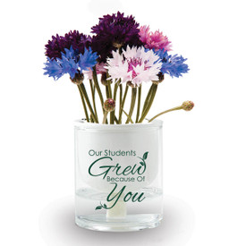 """Two-piece ceramic planter with glass water reservoir and 2 hydroponic wicks. Featuring the inspirational message """"Our Students Grew Because Of You."""" Grows a patriotic mix of flowers."""