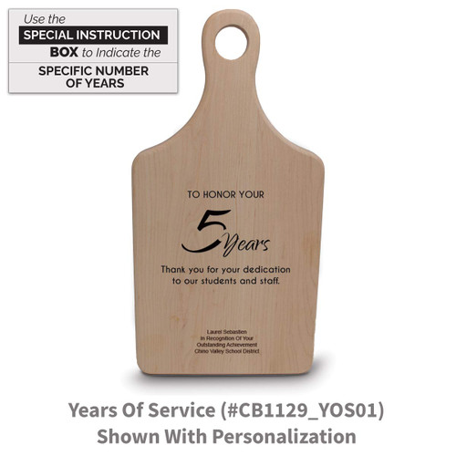 maple paddle cutting board with years of service message