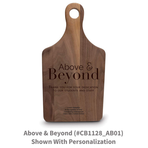 walnut paddle cutting board with above and beyond message
