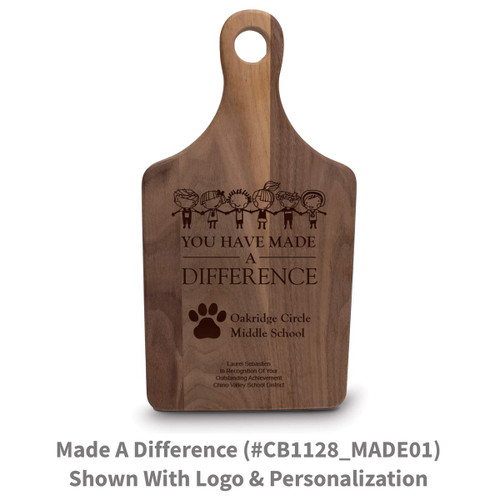 walnut paddle cutting board with made a difference message