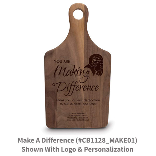 walnut paddle cutting board with making a difference message