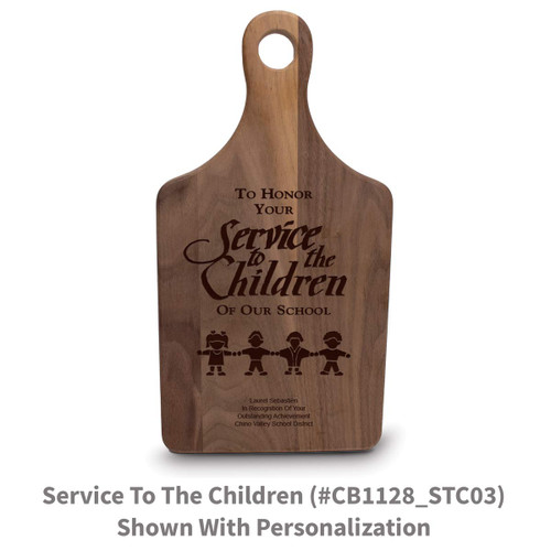 walnut paddle cutting board with service to the children message