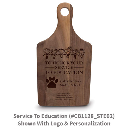 walnut paddle cutting board with service to education message