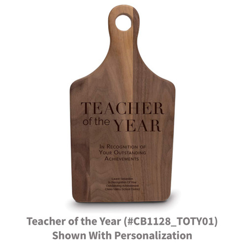 walnut paddle cutting board with teacher of the year message