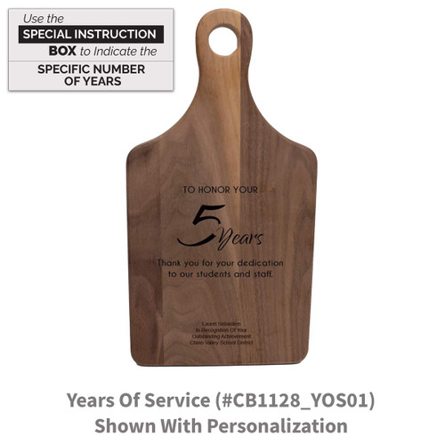 walnut paddle cutting board with years of service message