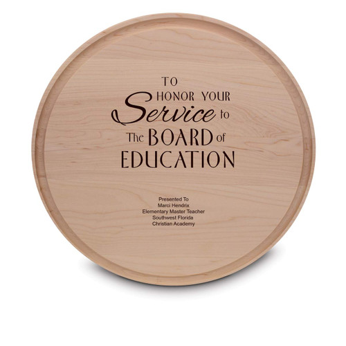 maple round cutting board with service to the board message