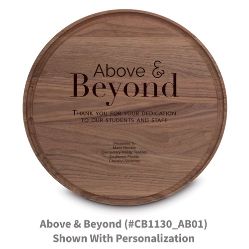 walnut round cutting board with above and beyond message