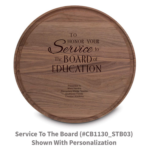 walnut round cutting board with service to the board message