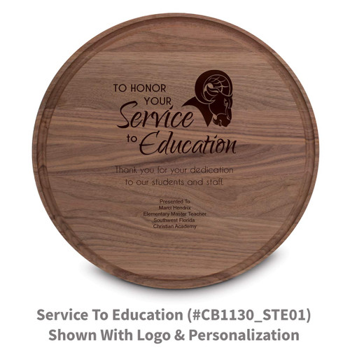 walnut round cutting board with service to education message