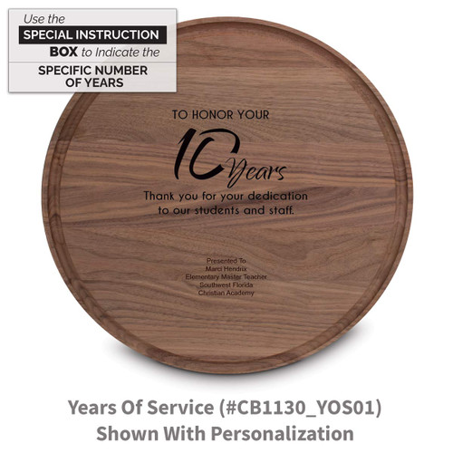 walnut round cutting board with years of service message