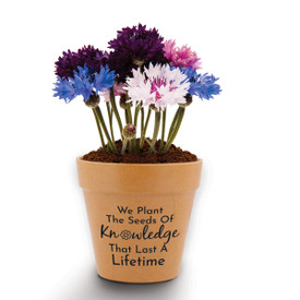 "This Mini Flower Pot Kit With Patriotic Seeds Features The Inspirational Message ""We Plant The Seeds Of Knowledge That Last A Lifetime"""