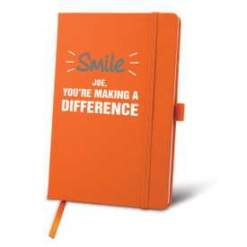 orange journal with smile you're making a difference message and personalization