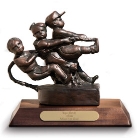 bronze statue of kids pulling a rope sitting on a walnut base with brass plate