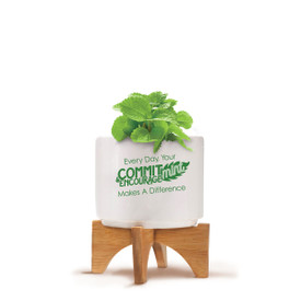 Bamboo Stand With White Ceramic Pot. Inspirational Saying: Every Day, Your Commit-Mint & Encourage-Mint Makes A Difference.